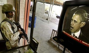 An Iraqi soldier watching US election coverage in Baghdad
