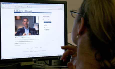 A woman looks at the Barack Obama campaign website