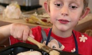 Andrew, 6, covers breadrolls with oil