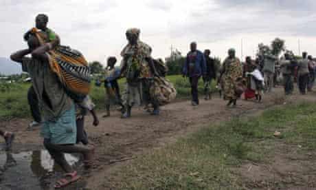 Congo civilians stream from Kiwanja to Rutshuru to escape what they said were attacks by pro-government Mai-Mai militia men in the area.