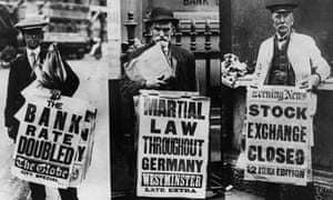 Three street news vendors displaying their headline boards relating to the financial crisis and martial law in Germany. August 1 1914