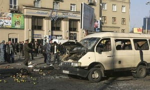 Investigators work at the scene of an explosion outside the main market in the southern Russian city of Vladikavkaz