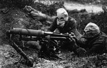 Soldiers in gas masks manning a machine gun