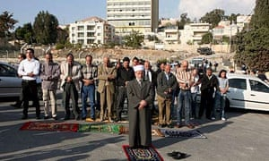 Palestinian residents of Sheikh Jarrah hold a prayer meeting in support of the al-Kurds after the court ruling against them. Photograph: Yossi Zamir/EPA