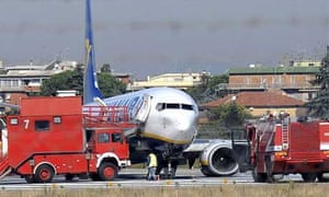 Emergency service vehicles surround the Ryanair jet that made an emergency landing at a Rome's Ciampino airport