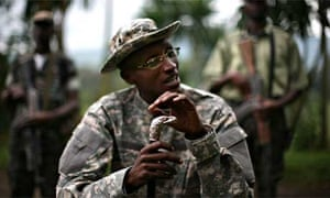 Rebel army leader Laurent Nkunda prepares to pose for a portrait at the headquarters of the  National Congress for the Defence of the People in Tebero, Democratic Republic of Congo