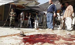 Blood stains the tiles following a suicide bombing in the Iraqi city of Baquba