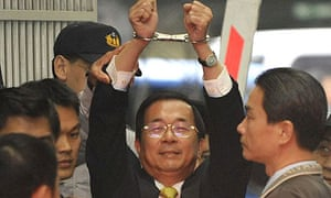 The former Taiwan president, Chen Shui-bian, is taken in shows handcuffs from the prosecutors' office to the Taipei district court