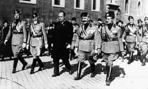 Benito Mussolini and four of his Generals, march on Rome, supported by their fascist troops