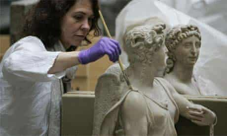 A sculpture conservator at work in the V&A museum, London
