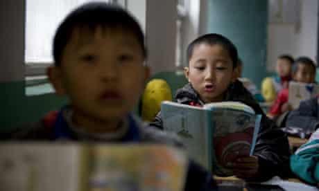 Children reading at school in Beijing, China