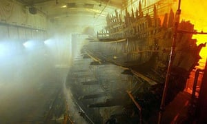 The remains of the Tudor warship Mary Rose as it sits in an atmospherically controlled dry dock in Portsmouth's historic dockyard