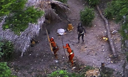 Members of an unknown Amazon basin tribe fire arrows at a spotter plane in May