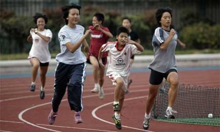 Child athletes train at the Xinzhuang track and field training base. Photograph: Dan Chung