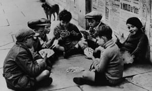 Homeless children play a card game in Paris during the second world war