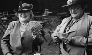 Two older ladies enjoy a game of cards