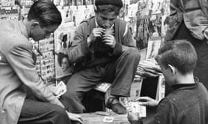 Boys play cards in the street