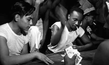 Stewards on board the USS Saratoga playing cards