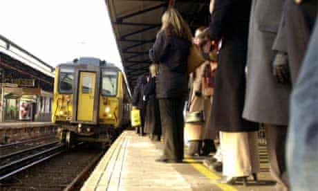 Commuters and rail passengers watch a delayed South West Trains service to London Waterloo from Clapham Junction in south London finally arrive, Thursday 3, January, 2002. More than 200,000 rail travellers face four days of chaos after eleventh-hour talks to avert strike action broke down last night resulting in the cancellation of most of South West Trains' 1,700 daily services , including busy commuter routes into London. PA Photo : Johnny Green.