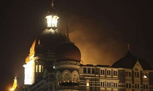 Smoke emerges from behind a dome on the Taj Hotel in Mumbai, India, after it was attacked by terrorists