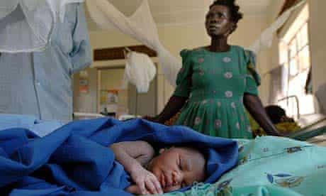 Florence Apeco with her newborn baby at Tiriri health centre, Katine, Uganda