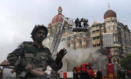 Soldier prevents people from approaching the Taj Mahal Hotel in Mumbai on November 29, 2008