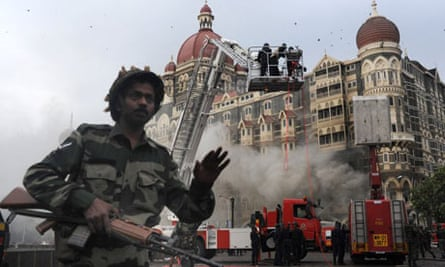 An Indian soldier prevents people from aproaching the Taj Mahal hotel after the rescue operation