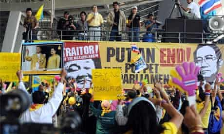 Anti-government protestors celebrate the court decision stripping the ruling party of power at the Bangkok's besieged Suvarnabhumi international airport