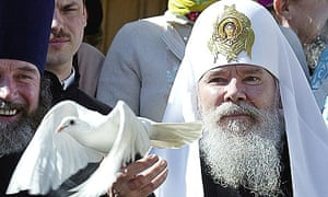 The late head of the Russian Orthodox church, Alexy II, releases a dove after a holiday service at the Kremlin, in April 2004