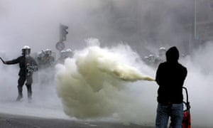 Youngsters clash with Greek riot police in the centre of Athens