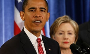 Barack Obama stands with Hillary Clinton at a news conference in Chicago