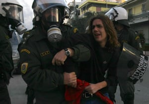 Gallery Greek riots: Police detain a youth during riots