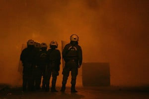 Gallery Greek riots: Riot police stand amidst tear gas