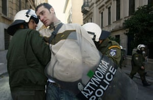 Gallery Greek Riots Continue: A protester is detained by police