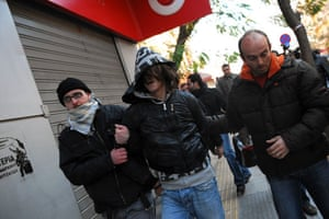 Gallery Greek Riots Continue: Greek police officers arrest a protestor