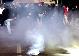 Gallery Greek Riots Continue: Young protestors escape from tear gas