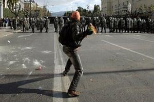 Gallery Greek Riots Continue: A protestor throws a molotov cocktail