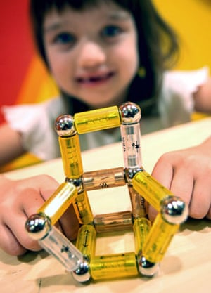 Gallery Children's toys: A girl plays with an Electro Mag toy
