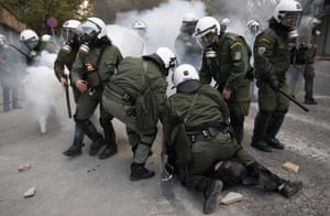 Gallery Greece riots: Police arrest a protester during clashes in Athens