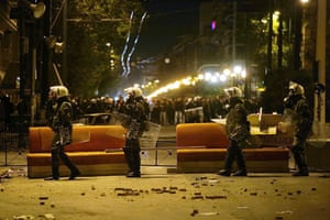Gallery Greece riots: Riot police walk past a barricade in Athens, Greece