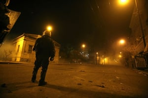 Gallery Greece riots: A riot police officer stands outside Athens Polytechnic