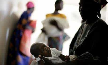 Katine: Six-week-old Ellen Beatrice Asano waits for her polio immunisation with her mother Naomi Abegno