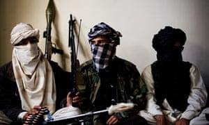 Qomendan Hemmet, taliban commander, between his two lieutenants in Wardak, Afghanistan