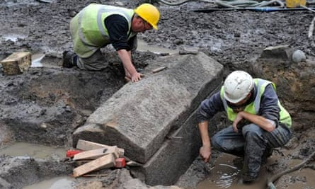 Archaeologists from Durham University clean a Roman stone sarcophagus