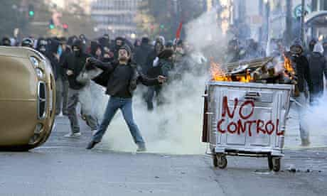 Protesters throw stones at riot police in central Athens