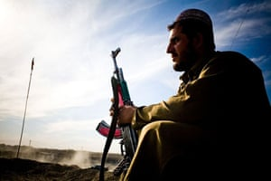 Gallery Life in Lashkar Gah: A police commander in his post in Lashkar Gah