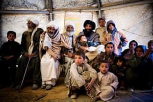 Gallery Life in Lashkar Gah: People wait for a doctor to examine them in a clinic in Lashkar Gah