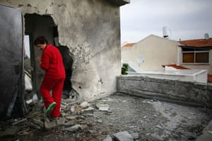Gallery 22 December 2008: Sderot, Israel: Maya Iber inspects damage at a her destroyed house