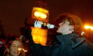 New Year's Eve reveller drinks champagne