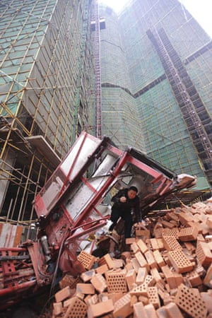 Gallery 24 hours in pictures: A rescuer at the scene of an elevator accident in China